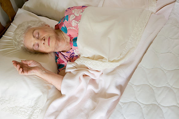 Elderly woman asleep in bed.jpg