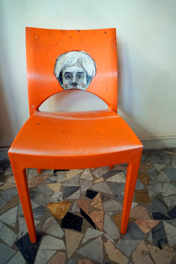 Andy W.- oil painting on a red plastic chair- 2016