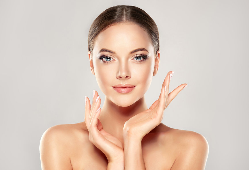 Beautiful Young Woman with Clean Fresh Skin  touch own face . Facial  treatment   . Cosmet