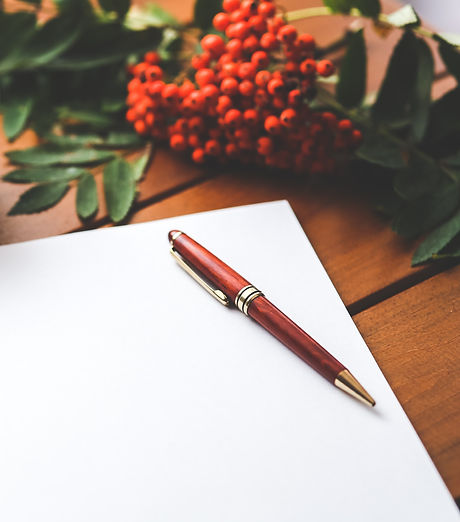 blank-paper-with-pen-and-coffee-cup-on-wood-table-6357_edited.jpg