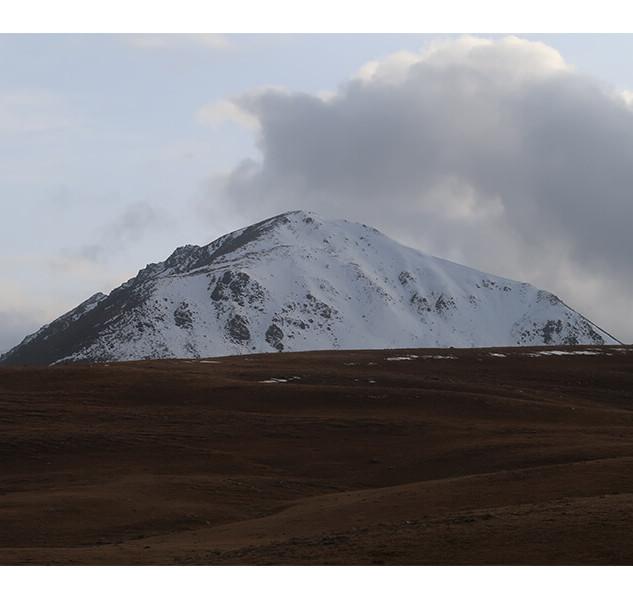A Snow-Capped Hilltop On a Big Descent