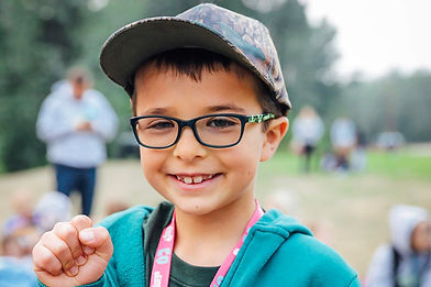 Smiling kid with glasses and a hat