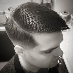 Low skin fade comb over using _wahlpro #magicclip and _andisclippers slimline pro