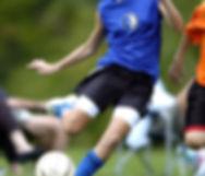 Socce player kicking a ball