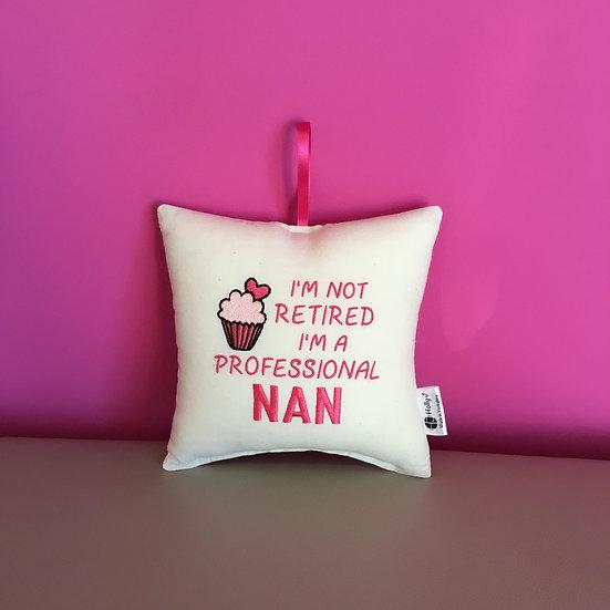 'I'm not retired I'm a professional Nan' Hanging Cushion