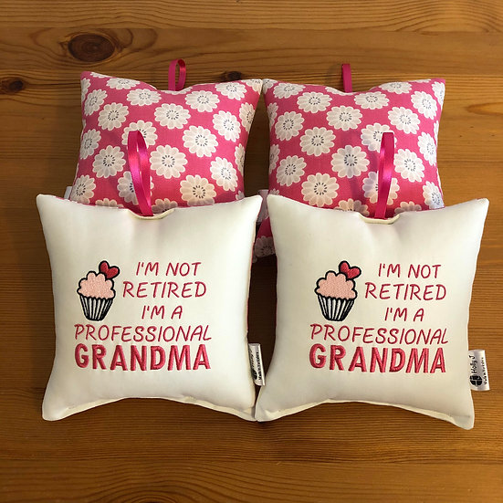 'I'm not retired I'm a professional Grandma' Hanging Cushion
