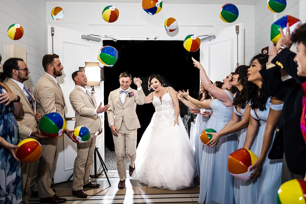 Bride and groom doing a beach ball exit at their Hilton wedding on Pensacola Beach.