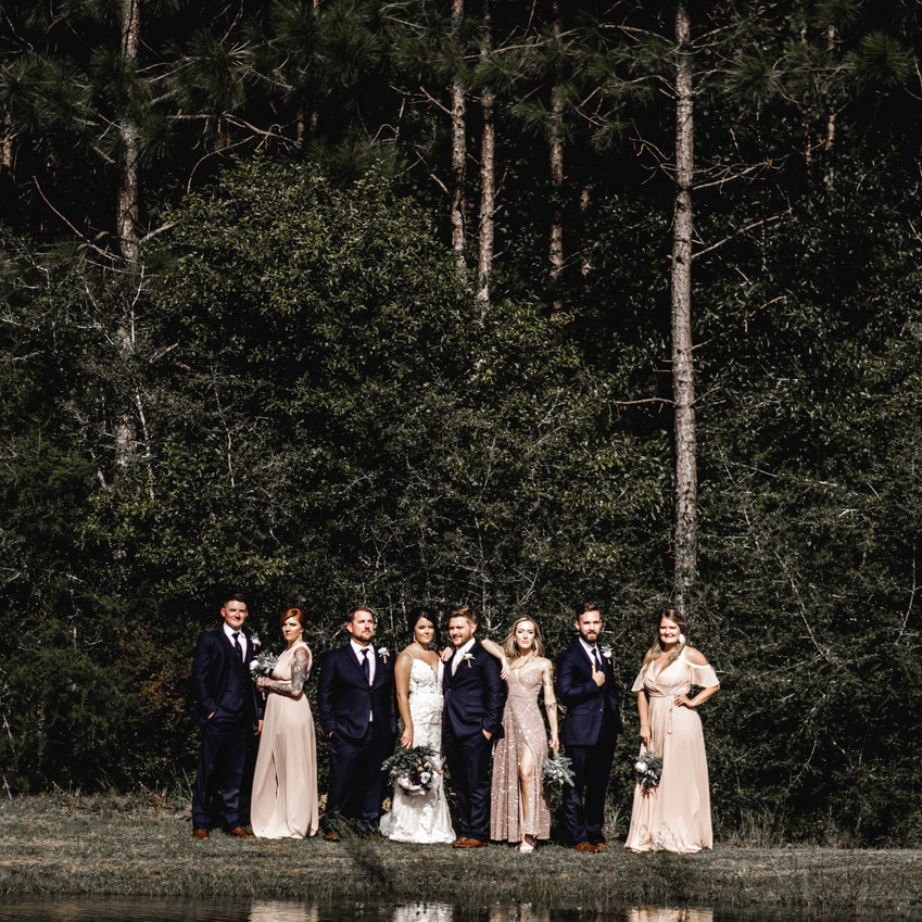 Wedding party in front of lake