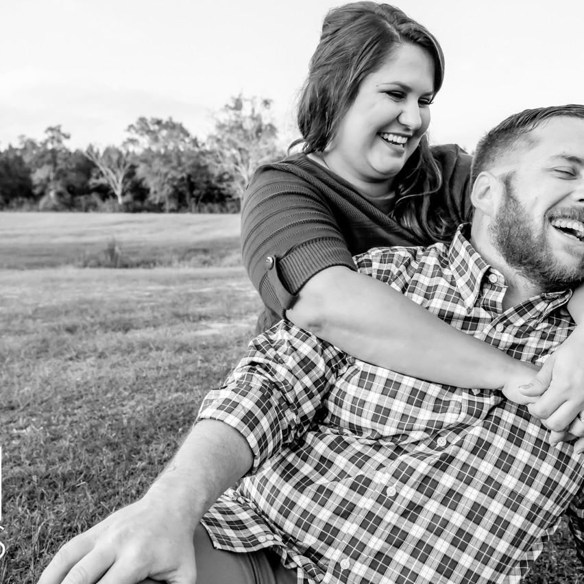 Engaged couple laughing at Sowell Farms