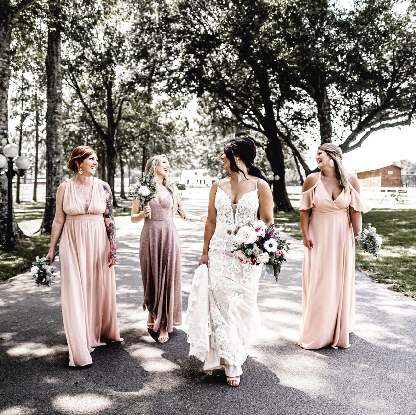Bridesmaids walking in the road