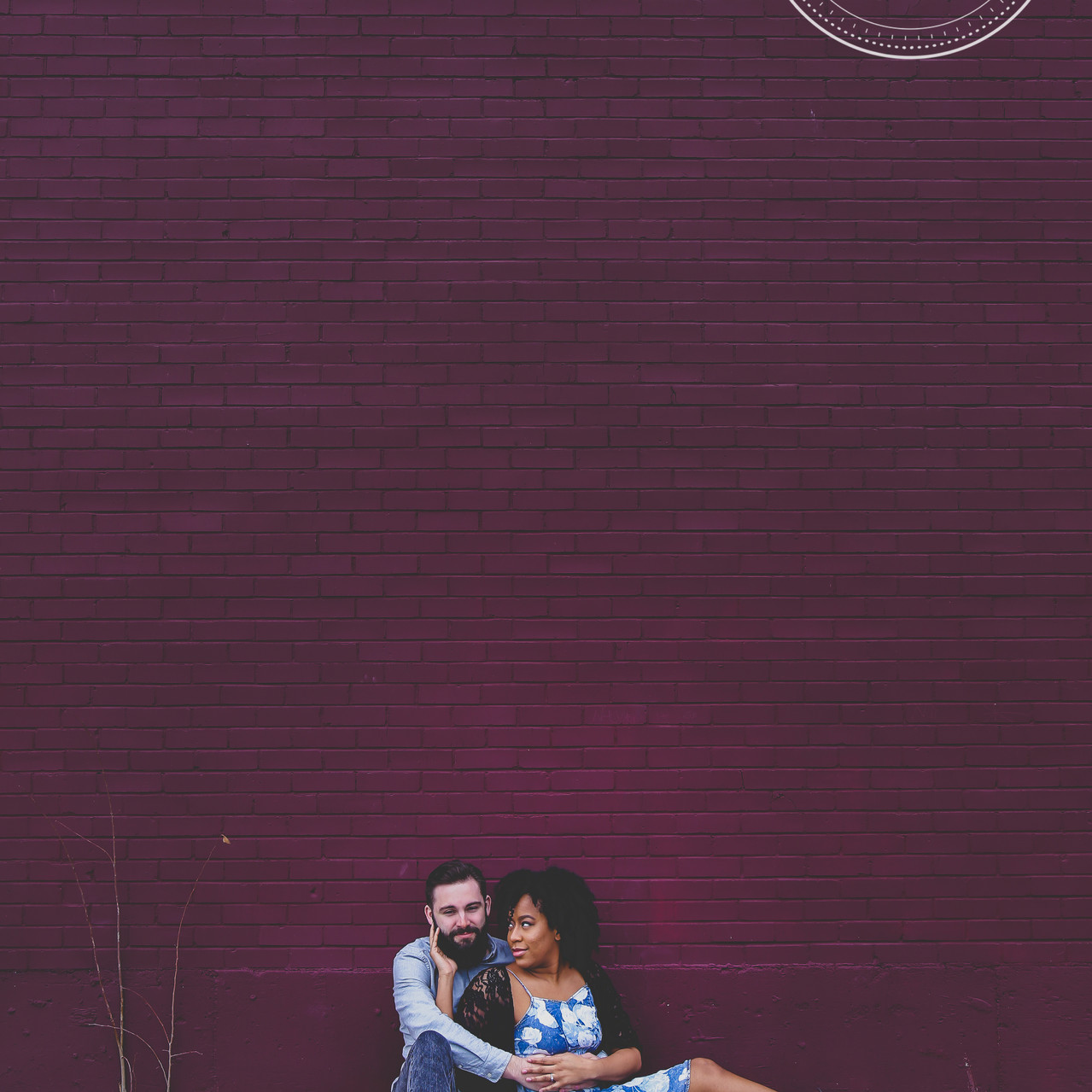 Couple in front of purple wall in Deep Ellum