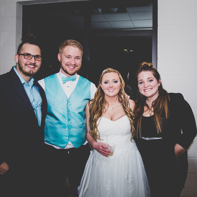 My wife and I with the Bride and groom