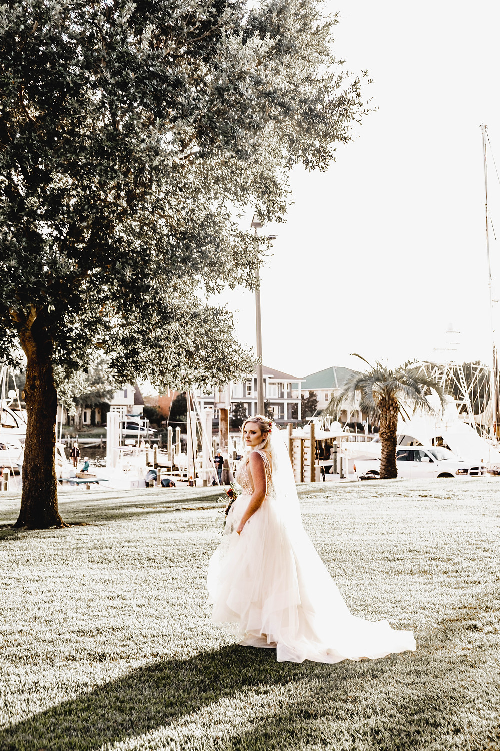 Bride holding bouquet while walking at Pensacola Yacht Club