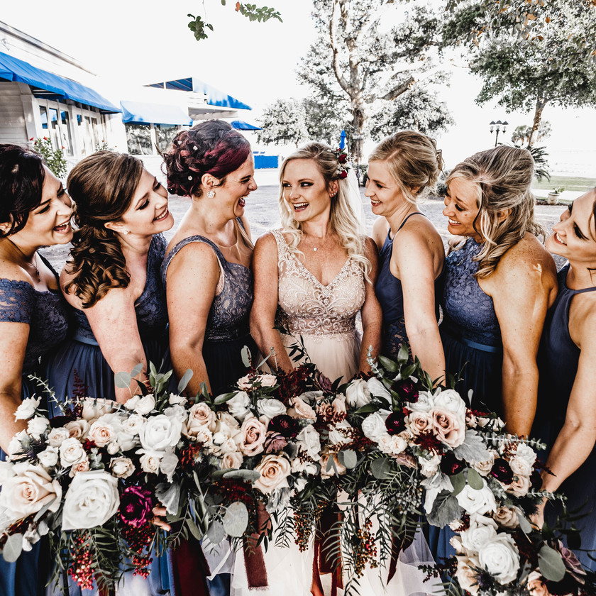 Bridesmaids laughing with each other