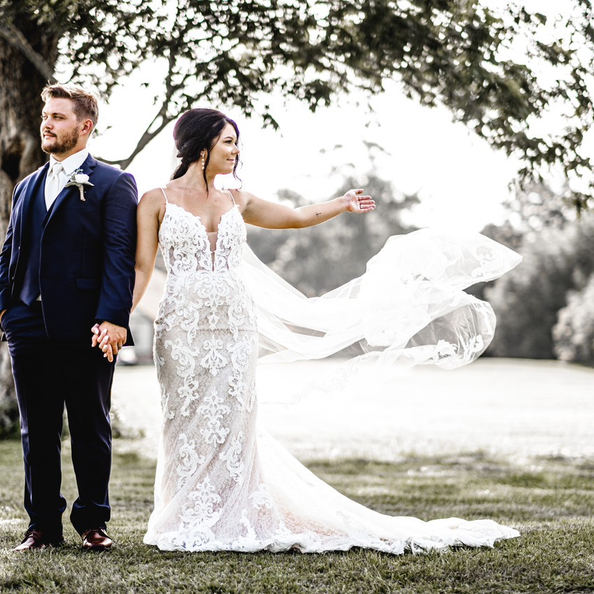 Brides veil blowing in the wind