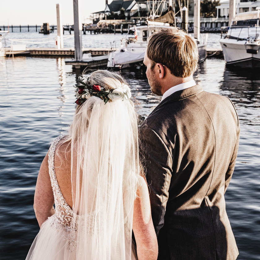 bride and groom look at yachts at Pensacola yacht Club