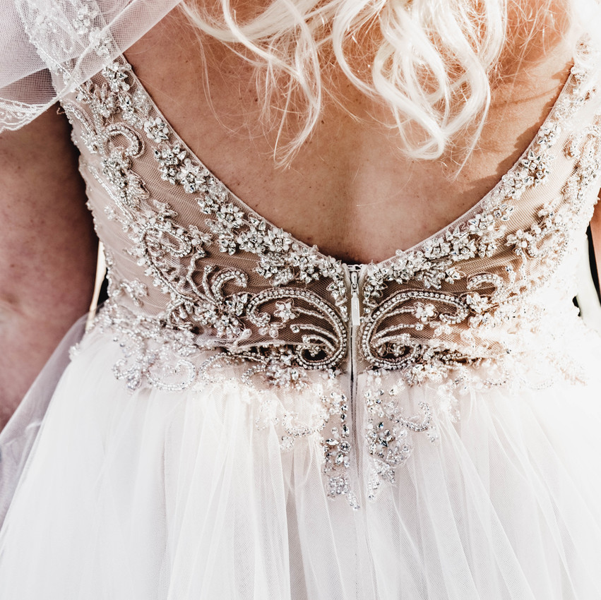 beaded back of a wedding dress