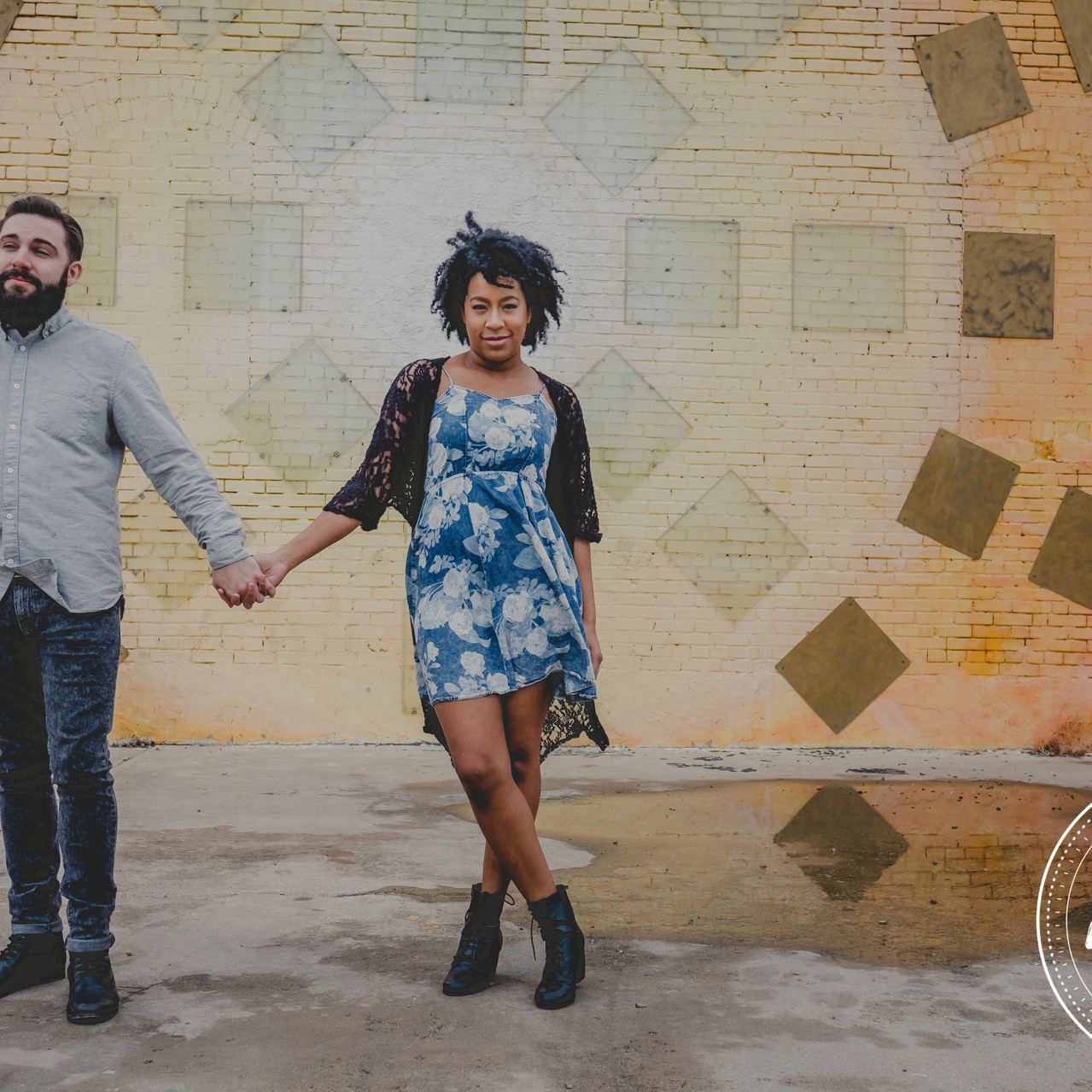 Couple in front of Yellow Wall in Deep Ellum