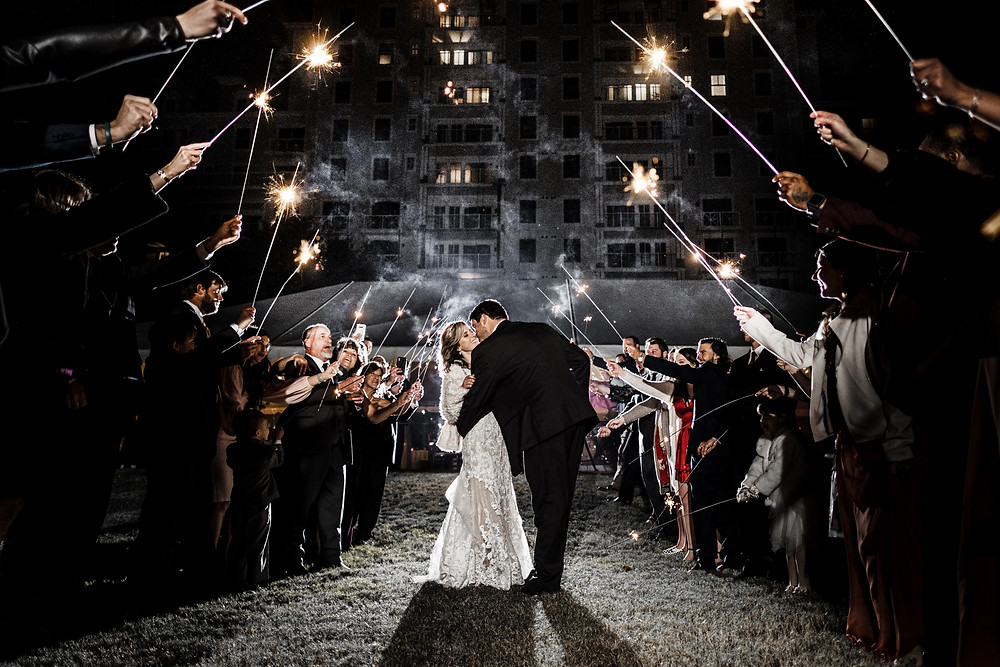 Bride and Groom during a sparkler exit at their Sandesting Golf and beach resort wedding.