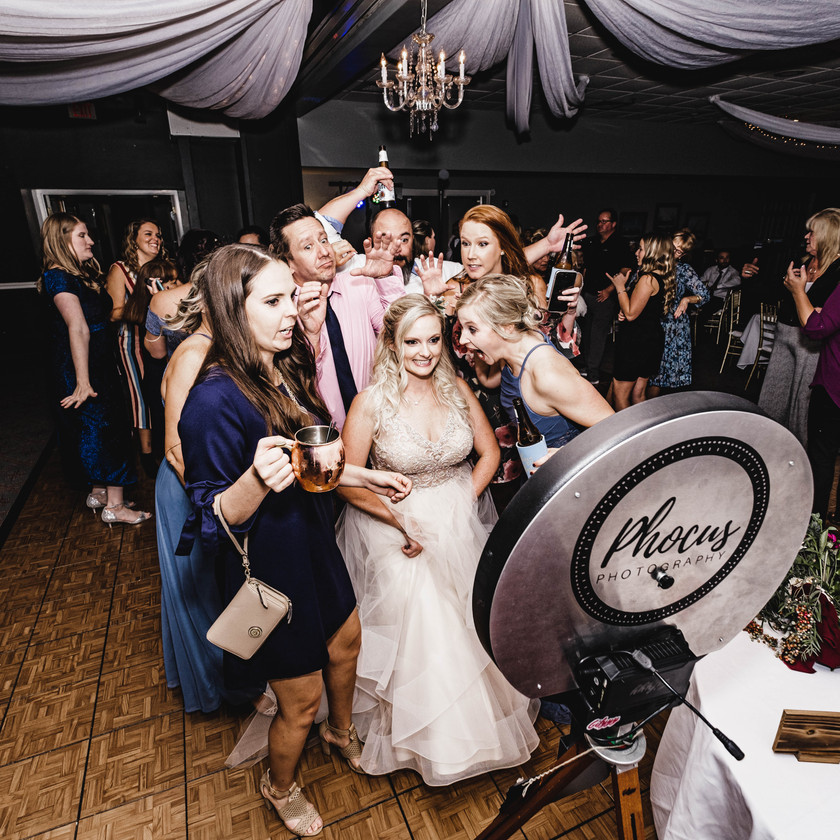Bride and her wedding guests having fun in Phocus Photography LLC Photo Booth