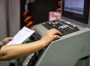 factory-worker-keyboard-command-machine.jpg