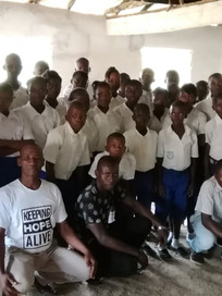 Mr Fraser with students and Mr Lamin Koroma (Director)