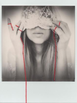 "Onirismo, realtà, onirismo. La fotografia ""istantanea"" di Angela Regina"
