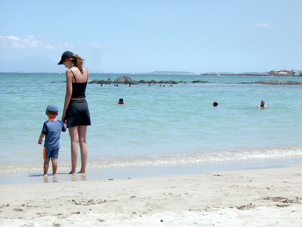 Mom at a beach with her child