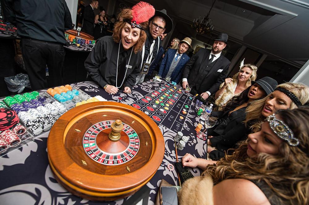 People enjoying roaring '20's theme gambling