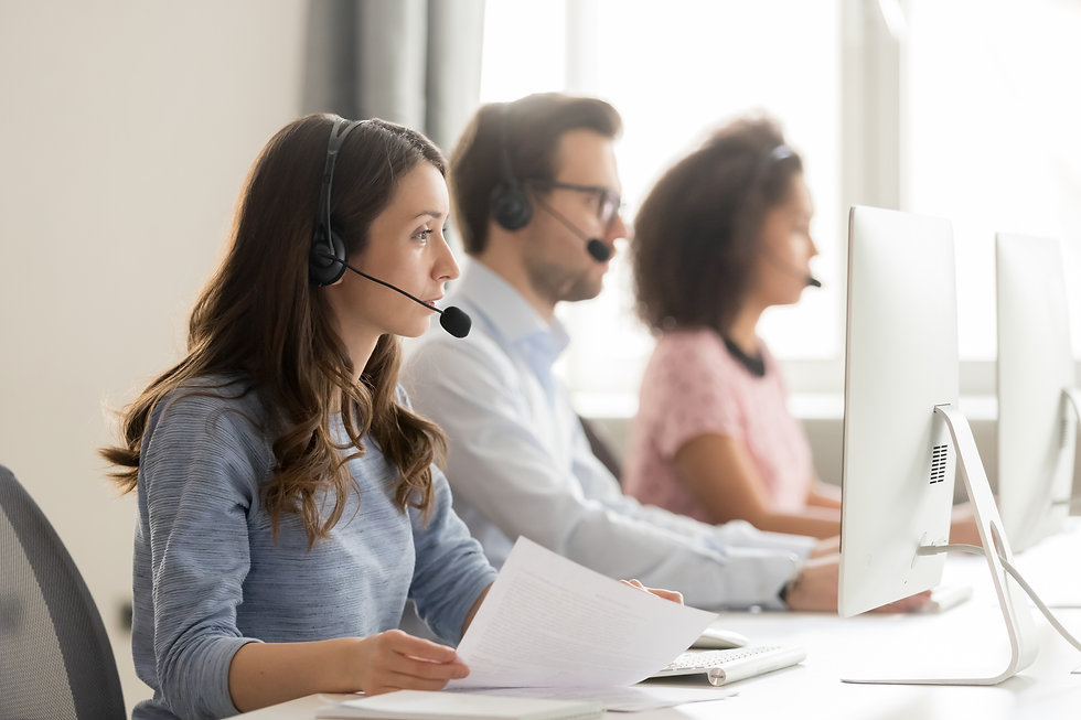 Diverse call center workers sitting in r