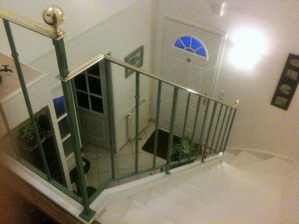 Rampe d'escalier laiton et bronze patiné