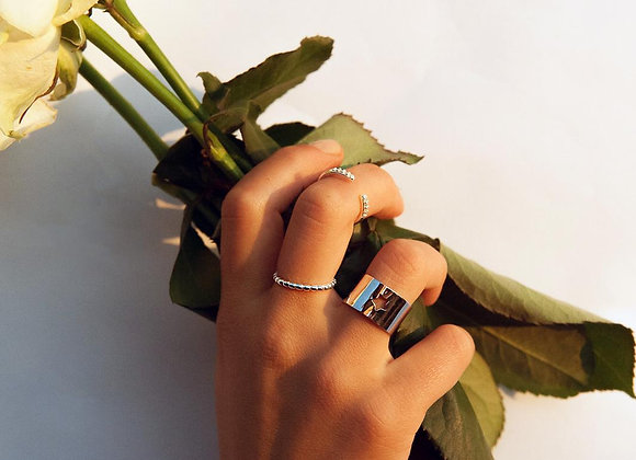 Anello argento semicerchio con 8 zirconi