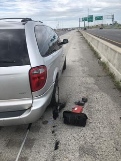 Van tire change on highway