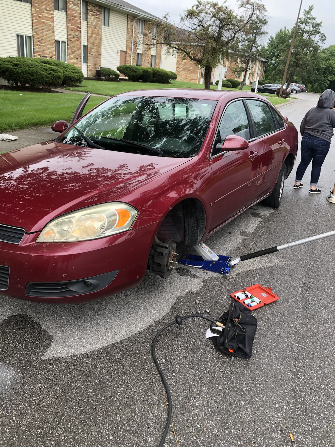tire replacement in parking lot of apartment complex