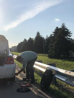 Good samaritan changing a tire