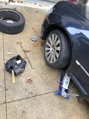 Audi A8 tire change in parking lot_edite