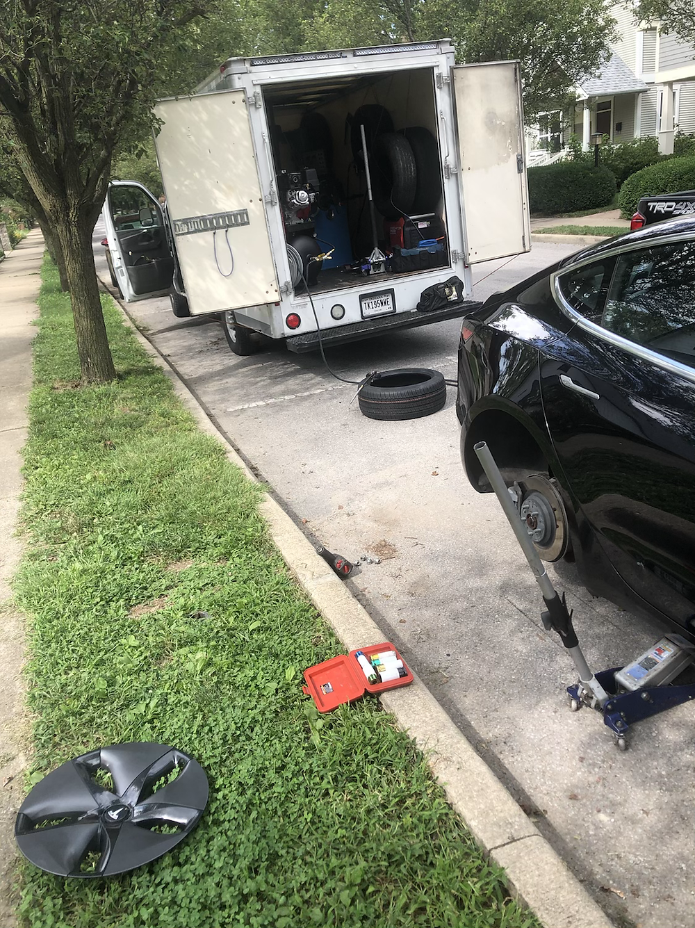 Mobile tire installation service on a Tesla.