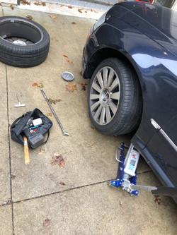 Audi A8 tire change in parking lot