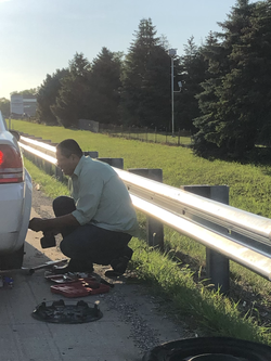 julio changing a tire