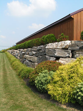 Boulder retaining wall at a commercial s
