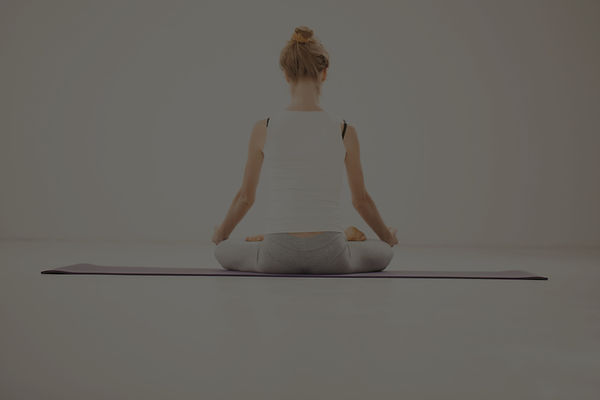 A person doing a lotus pose