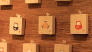 【まじないのハコをとじた】  小さな辻占のハコ  (部分)      桐箱 / 膠 水干絵具 石膏  色鉛筆 和紙  52 × 60 × 21mm  2019.4  ハコの外世界には縁起物 内世界には辻占(おみくじ的)要素  連れて帰っていただいた方だけとの秘密のまじない