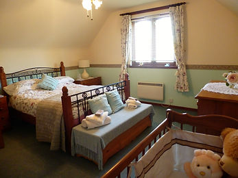 large double room with cot