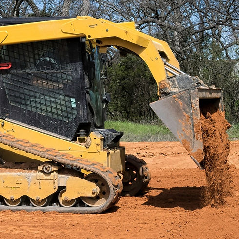 Skid Stear Loader Pouring Dirt onto foundation pad_edited_edited_edited.jpg