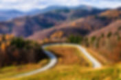 Car on the loop road curve on the hill o