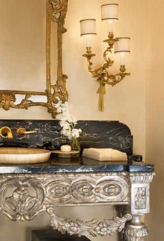 Black marble and honey onyx powder room