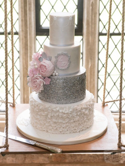 Silver ruffles wedding cake