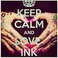 Keep calm and love ink slogan. Two beautifully tattooed female hands