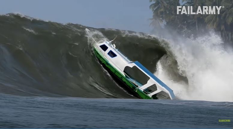 Boating getting capsized by giant wave