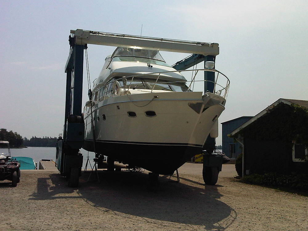 Boat being lifted to dry dock at marina